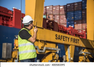 foreman control forklift handling the container box loading to truck in logistic zone