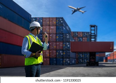 Foreman control loading Containers box to truck for Logistic Import Export Background, Business logistic concept, import and export concept