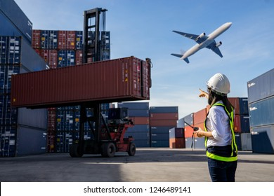 Foreman control loading Containers box to truck for Logistic Import Export Background, Business logistic concept, import and export concept.