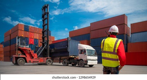 Foreman control loading containers box from cargo freight ship for import export, Business logistic concept, Import and export concept