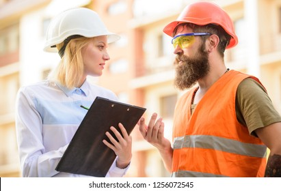 Foreman established supply of building materials. Expert and builder communicate about supply building materials. Construction industry. Successful deal concept. Purchase of building materials.