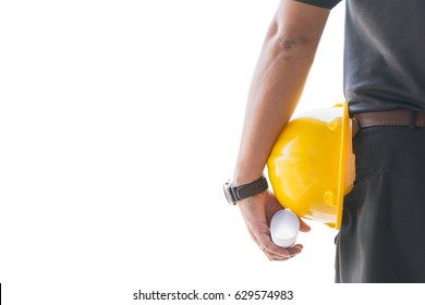 Foreman holding his helmet and blueprints  on white background with copy space.