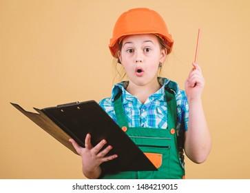 Foreman planning. Builder engineer architect. Future profession. Kid builder girl. Build your future yourself. Initiative child girl hard hat builder worker. Child care development. Safety expert.