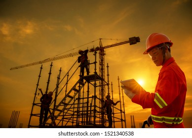 foreman supervisor engineering checking construction site silhouette sunset time