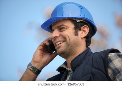 Foreman talking to colleagues via radio