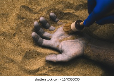 Forensic expert discovering dead body buried in desert sand. Conceptual image for police investigation of an cold case murder crime scene.