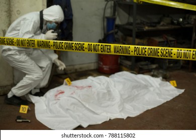 Forensic investigating the rime scene.