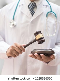 Forensic medicine legal investigation or medical practice - malpractice justice concept with judge gavel in doctor's hands