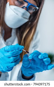 Forensic science expert examining evidence, looking for traces of DNA