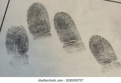 Forensic science.Samples of fingerprints isolated on white paper