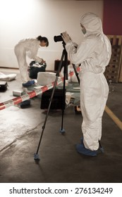 Forensics students on crime scene with camera