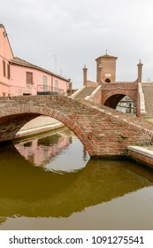 "foreshortening of ancient monumental ""Borgo"" and ""Trepponti"" Baroque bridges, shot in bright light at Comacchio, Ferrara, Italy"