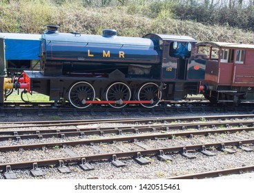 Forest of Dean, UK. 18th April 2018 Dark blue LMR steam train engine on tracks Engine No 152 with wooden workers carriage