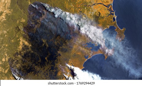 Forest fires in Australia, a view from space. Environmental problems, a large fire in the forest, a burned-out section of forest. Satellite photo, contains modified Copernicus Sentinel data