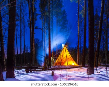 Forest home of the Indians. Wigwam with moonlight. The life of nomadic tribes. The wigwam stands in the forest. A hut of nomadic peoples. A home of Indians. Type in the forest.
