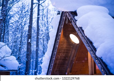 a forest hut with heavy snow