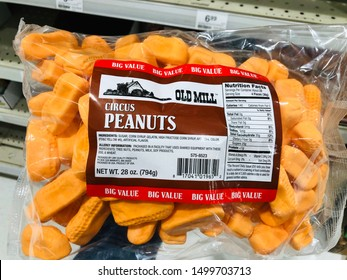 Forest Lake, MN - August 31, 2019: Hand holds up a package of Old Mill brand Circus Peanuts candy while shopping in a grocery store