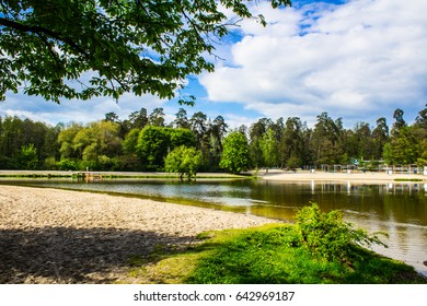Forest landscape. Sandy beach in the forest near the lake and the river in the village of Pushcha-Voditsa, Kiev region, Ukraine.