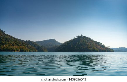 Forest, mountain, river and blue sky