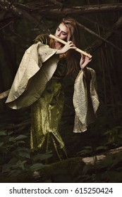 Forest princess playing flute . Romance and fantasy