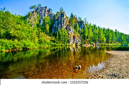 Forest river water in mountains. Mountain forest river landscape. River forest in mountains. Mountain forest river view