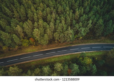 Forest road from above, Aerial view of a provincial road passing through a forest Riga, Latvia