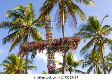 Forest of St. John, Bahia / Brazil - August 21, 2019: Cross with rinbbons of the Lord of Bonfim.