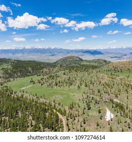 Forest trees and meadows in the vast Rocky Mountains of Wyoming in North America.