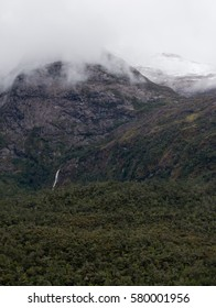A forest waterfall near the base of the Patagonia mountains.