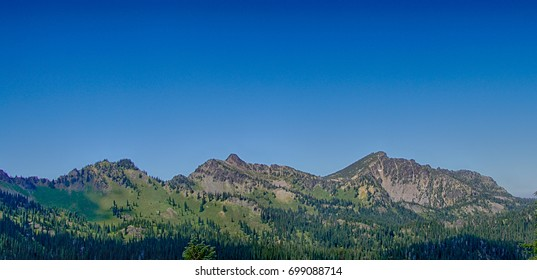 Forested mountains, hills and valleys to the southeast of Mount Rainier, National Park, Washington