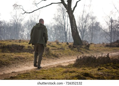 Forester searching for some wildlife in the National Park 'The Veluwe', the Netherlands
