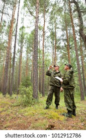 Foresters determine the direction of the sanitary felling area using a geodesic compass.