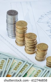 Forex charts and dollar coins