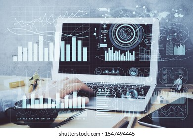 Forex graph with businessman working on computer in office on background. Concept of hardworking. Double exposure. - Shutterstock ID 1547494445