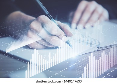 Forex graph on hand taking notes background. Concept of research. Multi exposure