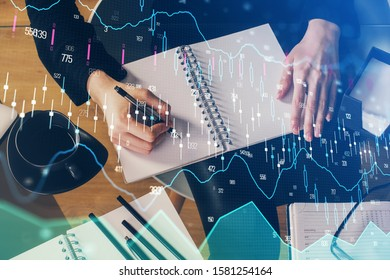 Forex graph on hand taking notes background. Concept of research. Multi exposure - Shutterstock ID 1581254164