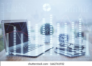Forex market graph hologram and personal computer on background. Double exposure. Concept of investment.