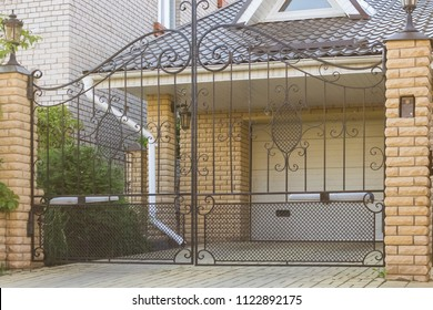 Forged automatic swing gates in a private house