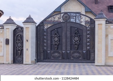 Forged black swing gates in the cottage