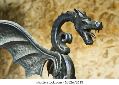 Forged figure of a winged dragon, old castle decoration