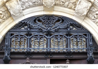 Forged iron grids in front of glass window