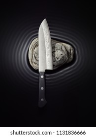 forged knife on black background