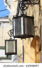 Forged lanterns above the entrance