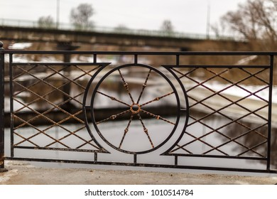 forged lattice on the city waterfront