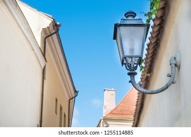 Forged metal streetlight at old european street with blue sky