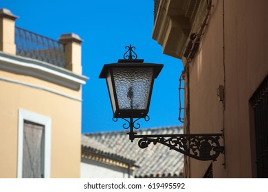Forged wall lantern with water seeded glass. Seville, Andalusia, Spain, Western Europe.
