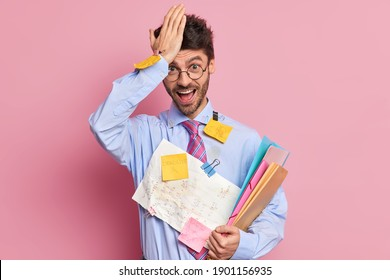 Forgetful student remember about one more task before exam keeps hand on forehead poses with papers tries to learn all formulas makes memo notes to keep everything in mind. Studying concept.