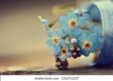 Forget-me-nots with a blue tape lie on a table