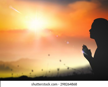 Forgive concept: Silhouette prayer woman pray to God on autumn sunset background