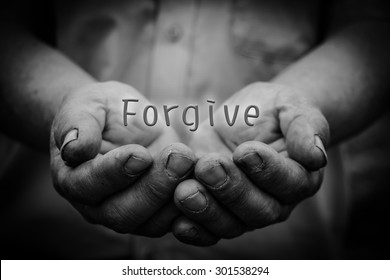 Forgive text is in the holding hands with dark corners.
